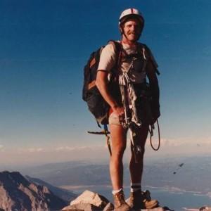 DP on summit of the Grand Teton with Jackson Lake, 1992